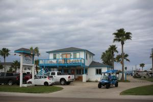 Port Aransas is a quaint fishing village on the Gulf of Mexico. It is situated on the northern tip of a barrier island, lying 18 miles offshore from Corpus Christi at Mustang Island. This 18-mile stretch of clean, sandy beach offers visitors birding, shelling, fishing, beach combing, surf fishing, or just plain relaxation.